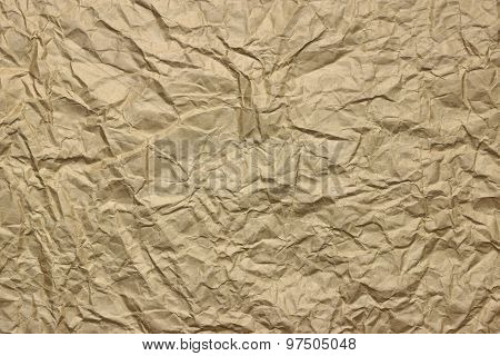 Close-up Of Rough Golden Brown Wrinkled Packaging Paper Texture Background