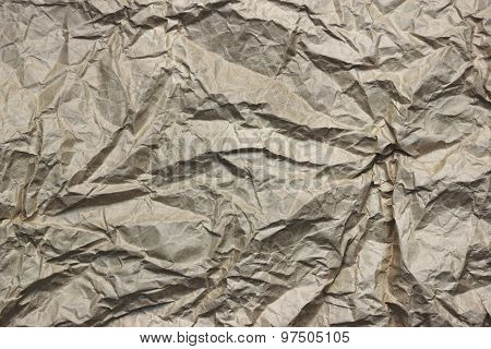Close-up Of Rough Brown Wrinkled Packaging Paper Texture Background