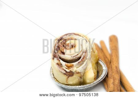 Mini Cinnamon Roll With Cinnamon Stick Isolated