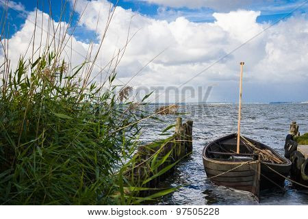 Landscape On Lieper Winkel On The Usedom Peninsula With Boat In Foreground