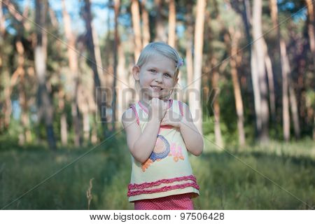 Baby Girl Blonde In The Forest.