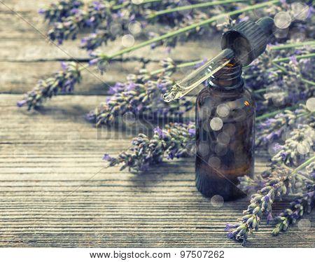 Perfumed Herbal Oil Essence And Lavender Flowers. Vintage Style Toned