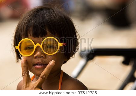 Baby with yellow glasses