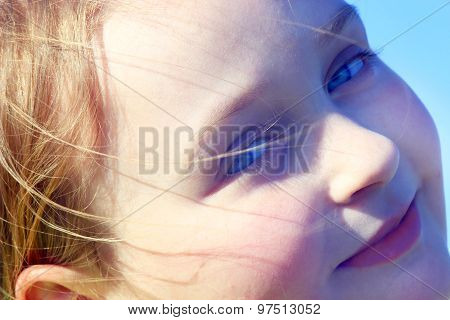 Portrait Of Little Squinting Girl With Nice Face