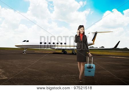 Business Travel Woman Walk With Suitcase Into Private Jet Airplane