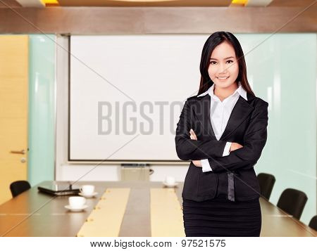 Asian Business Woman With Folded Hand Smiling
