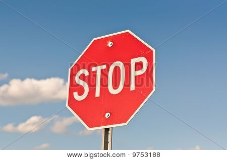Stop Sign With Blue Sky And Clouds