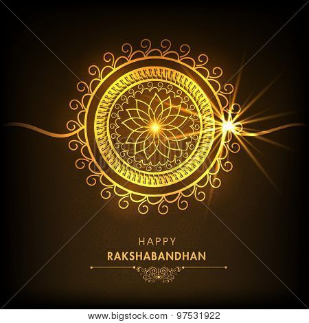 Creative floral design decorated golden rakhi on shiny brown background for Indian festival, Raksha Bandhan celebration.