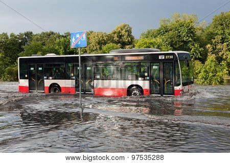 GDANSK, POLAND - July 28: Bus trying to drive against flood on the street on July 28, 2015 in Gdansk, Poland. Storms and heavy rains hit many parts of Poland and Europe