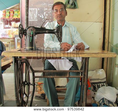 man is working with sewing machine