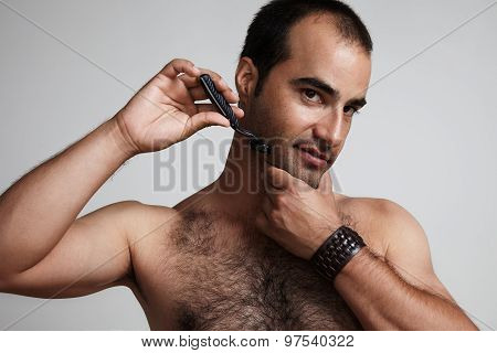 Man With A Razor Is Shaving