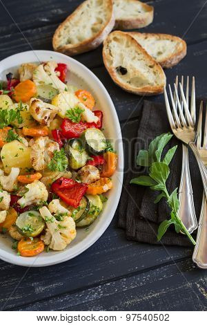 Roasted Vegetables - Zucchini, Cauliflower, Potatoes, Carrots, Onions, Peppers, On An Oval Dish On D