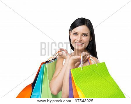 A Happy Young Girl With The Colourful Shopping Bags From The Fancy Shops. Isolated.