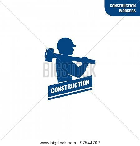 Construction worker holding sledge hammer