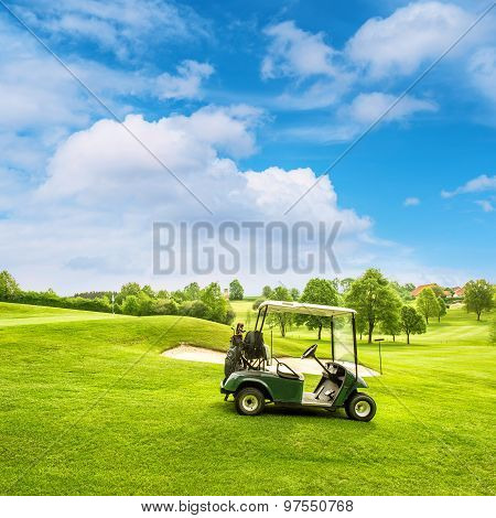 Golf Course Lanscape With A Cart Over Blue Sky