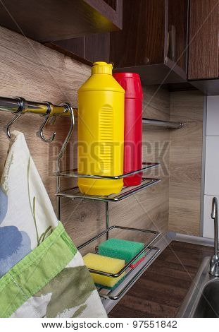 Shelf With Cleaners In The Kitchen. Interer