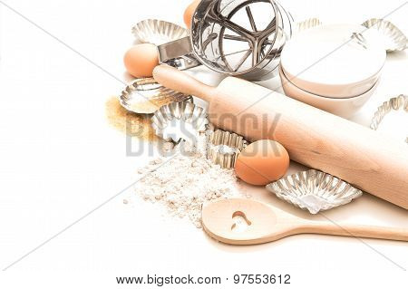Baking Ingredients And Tolls For Dough. Flour, Eggs, Rolling Pin And Cookie Cutters