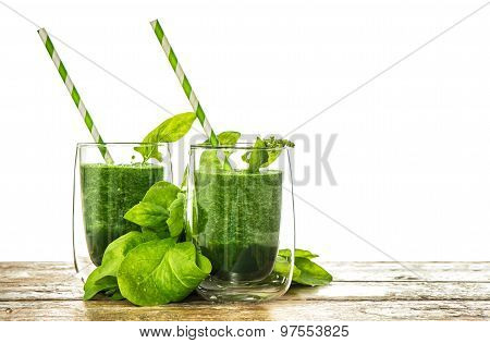 Healthy Green Spinach Leaves Smoothie In Transparent Glass