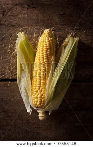 fresh corncob on a wood background