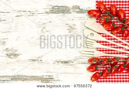Kitchen Utensils And Red Tomatoes. Retro Stale Toned Picture