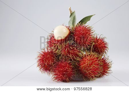asian fruit rambutan on the plain background