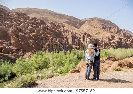Inter ethnic couple of tourists in Dades Gorges, Morocco