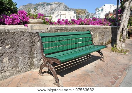 Empty bench during the siesta time in Italy town