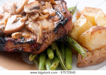 Grilled Pork Chop With Apple Mushroom Sauce