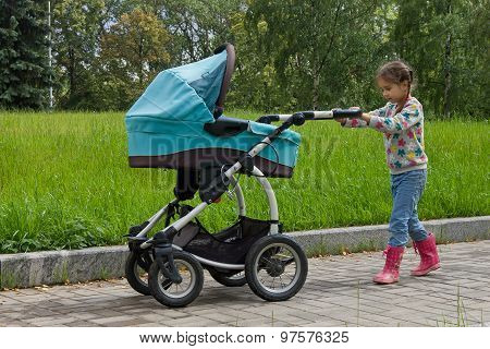 little girl with the stroller