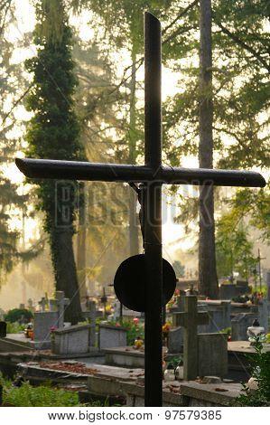 Metal Cross On A Graveyard