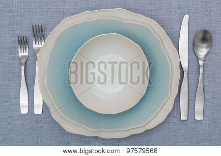 Empty Plate, Silverware And Table Cloth Background. View From Above With Copy Space