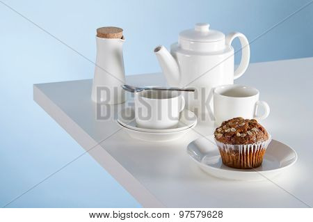 The Typical Spanish Plain Muffins, On A Set Table With A Cup Of Coffee And A Milk Pot In The Backgro