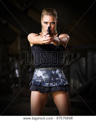 Young woman in uniform with gun (dark version)