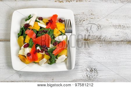 Healthy Fresh Salad And Fish On Plate With Rustic White Wooden Boards