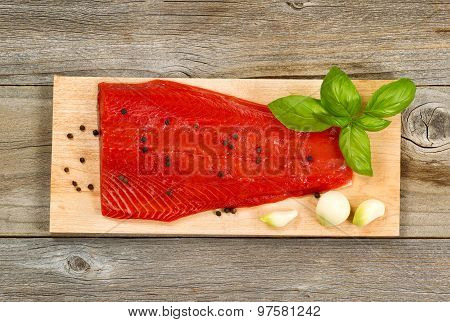 Fresh Red Salmon Fillet On Cedar Cooking Plank With Spices And Herbs