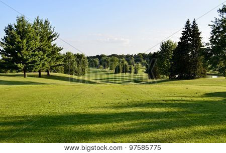 Beautiful golf course vista on a sunny summer evening