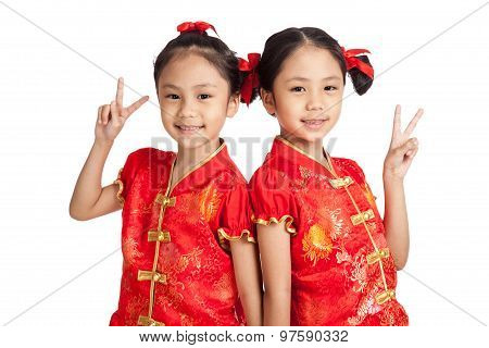 Asian Twins Girls In  Chinese Cheongsam Dress  Show Victory Sign