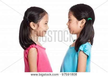 Happy Asian Twins Girls  Smile Look At Each Other