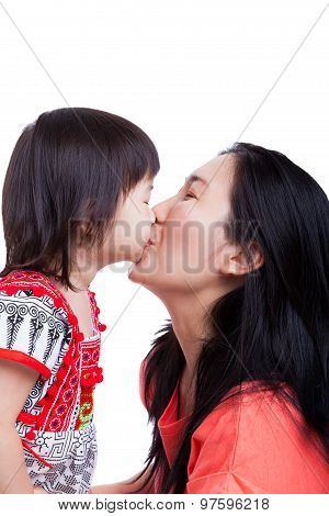 Mother And Daughter Kissing On White Background. Mothers Day