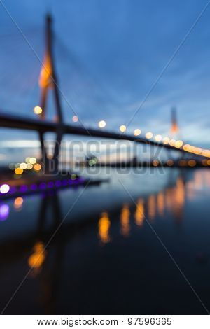 Abstract blurred bokeh light of twin suspension bridge