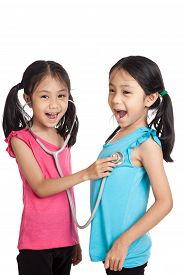 picture of identical twin girls  - Happy Asian twins girls with stethoscope isolated on white background - JPG