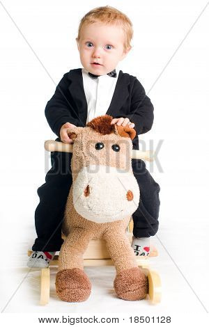 Baby In Tailcoat On Rocking Horse