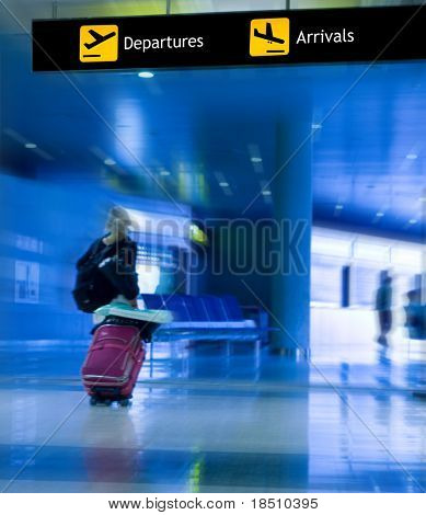 An Airline Passenger Walking in the Airport