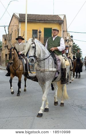 VALENCIA, SPAIN - JANUARY 24: Horses and riders in custom Spanish dress ride in the San Antonio parade on January 24, 2010 in Valencia, Spain.