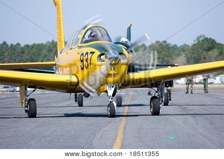 PALM COAST, FLORIDA - MARCH 27: Pilots prepare to take off at the Wings Over Flagler Air Show at the Flagler County Airport on March 27, 2010 in Palm Coast, Florida.