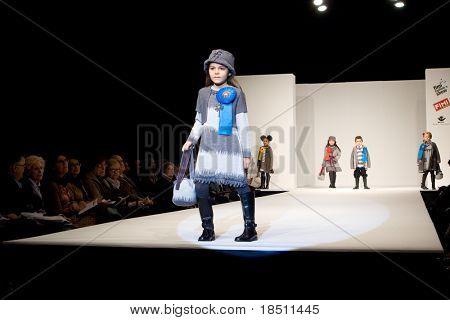 VALENCIA, SPAIN - JANUARY 22: Model Maria Gutierrez, age 11, of Valencia on the catwalk in the Valencia Children´s Fashion Show with the designer Barcarola on January 22, 2010 in Valencia, Spain.