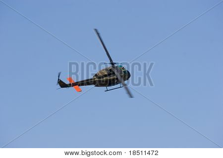 PALM COAST, FLORIDA - MARCH 27: An UH-1 Huey military utility helicopter flies at the Wings Over Flagler Air Show at the Flagler County Airport on March 27, 2010 in Palm Coast, Florida.