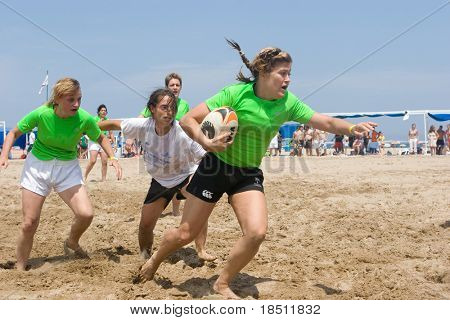 VALENCIA, SPAIN - JULY 3: Girls Rugby teams participate in the City of Valencia XIV International Beach Rugby Competition on July 3, 2010 in Valencia, Spain.