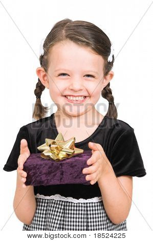 little girl holding up wrapped present to give you, isolated over white