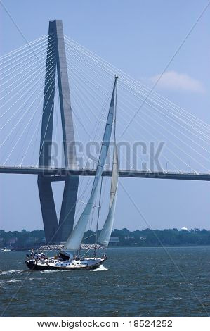 small sailing yacht racing through charleston harbor